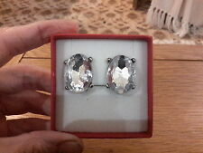 Brand new large silver tone clip-on earrings with large diamond look stones +box