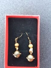 Drop earrings on bronze wires, with pearls, stones and bronze pendant finials.