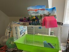 Used Rat Cage With Two: Bags Of Food, Bedding And Two Exercise Balls.