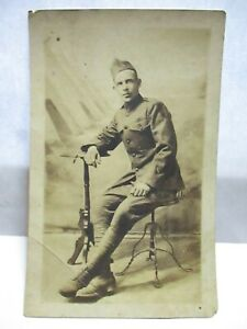 WWI REAL PHOTO POSTCARD HANDSOME U.S. SOLDIER IN UNIFORM, STUDIO POSE UNUSED