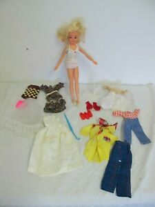 VINTAGE SINDY  GEN  DOLL WITH ORIGINAL DRESS STAND SHOES MORE