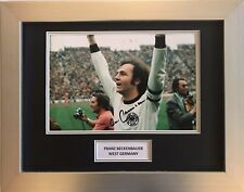 FRANZ BECKENBAUER HAND SIGNED WEST GERMANY AUTOGRAPH FRAMED PHOTO DISPLAY.
