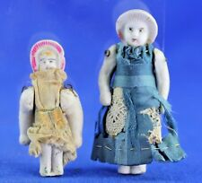 Pair Of Antique Stone Bisque Doll House Dolls Molded Bonnets Wire Jointed