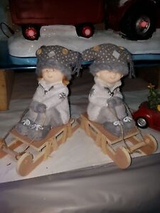 Snow children on sledges. Christmas Ornament