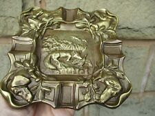 ANTIQUE/ VINTAGE FOOTED BRASS ASHTRAY EMBOSSED WITH GUN DOG HUNTING SCENE.
