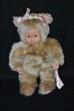 Peluche doudou poupée ours ANNE GEDDES beige visage plastique noeuds  24 cm TTBE