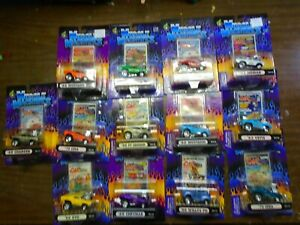 Lot Of 13 1/64 2000 Muscle Machines Diecast Cars CARTOONS Free shipping.