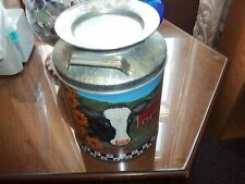 vintge milk urn tin barn scene with cow collectible stands approx 12 in./7 in. w