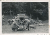 1945 WWII 193rd FA, Germany GI's Photo #2 fixing tires