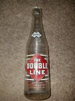 The Double Line Soda 7 1/2 oz. bottle Seminole , Lebanon Missouri, painted label