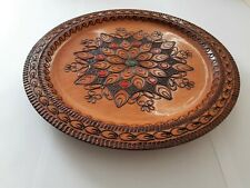 Old handmade wooden plate from1935 by Polish craftsmen from the Polish Zakopane.