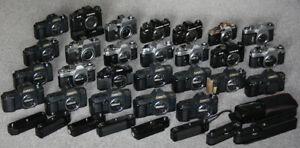 Konvolut Kameras 27 Stück, 8 Winder, überwiegend Canon FD, defekt für Bastler