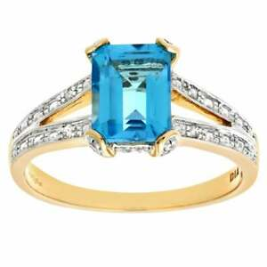 Naava 9ct Yellow Gold Blue Topaz with Diamond Set Collette and Shoulders Ring