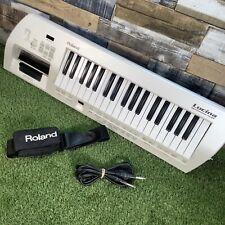 ROLAND Lucina AX-09 KEYTAR Synthesizer - Retro White Keyboard - Shoulder Strap