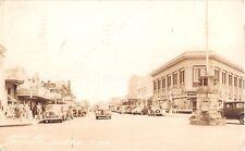 1942 RPPC Stores Cars Main St. Sarasota FL