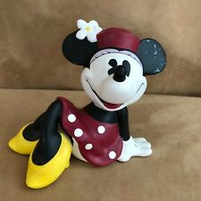 Minnie Mouse Ceramic Piggy Bank by Enesco reclining kicking back