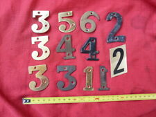 Lot of house or letter box numbers. 12 in total. Craft.