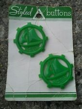 """Vintage 1 and 9/16"""" green plastic Sailboat buttons on card."""