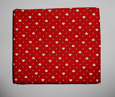 1 metre in cotton poplin with tiny white hearts and spots on red background
