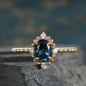 2.50Ct Oval Cut Blue Topaz Diamond Halo Engagement Ring 14K Rose Gold Finish