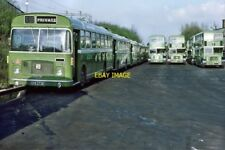 PHOTO  EASTERN NATIONAL BUSES STAND IN THE YARD AT BASILDON GARAGE 1976