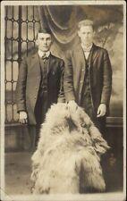 Men Holding Bear Fur Princeton Wv Photo Studio on Back c1910 Rppc
