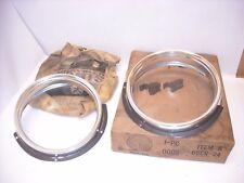 MOPAR NOS 1965 DART FRONT HEAD LAMP HEAD LIGHT BEZELS 2445234, 2545235