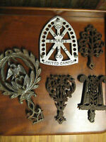 5 VINTAGE CAST IRON FOOTED TRIVETS JAS SMART, GRISWOLD, WILTON