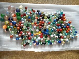 1.671 Kilograms of Vintage MARBLES some really nice ones in this lot.