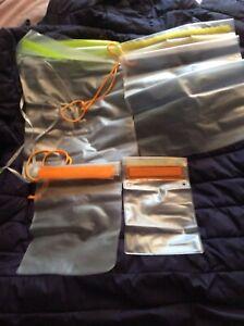 4 waterproof resealable, plastic cases, unused, various sizes.