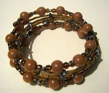 Gorgeous wrap around style bracelet with brown & bronze coloured beads very chic