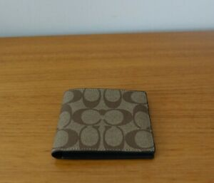 COACH MEN'S COMPACT ID WALLET IN SIGNATURE CANVAS IN TAN/BLACK COLOR. NWT