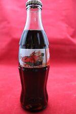 1995 Coca Cola Christmas Bottle Santa in Chair