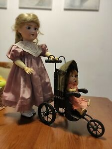 Antique stroller for dolls made of metal and wood