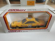 Tomica Dandy Nissan Skyline 2000 RS #50 in Yellow/Black on 1:43 in Box