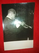 Vintage photo by Jacques Boutinot showing Louis Armstrong playing the trumpet