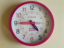 Tell the time pink child's battery powered wall clock