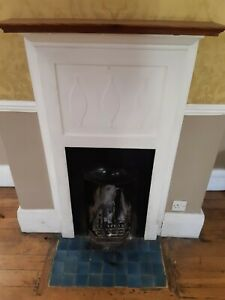 Small Cast Iron Fireplace with Wooden Surround