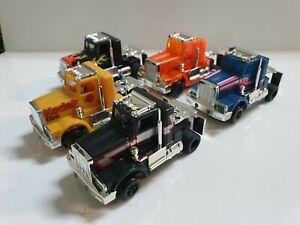 TYCO peterbilt trucks set of 5 TRUCKS WITH RUNNING CHASSIS. SLOTCAR .COOL!