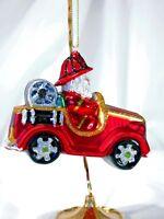 TJ's Christmas Santa Driving Fire Truck plastic silvered ornament