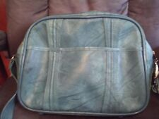 light blue american tourister ?leather? carry-on luggage
