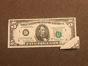 Mint error printed fold on a $5 Federal reserve note