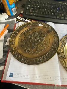 ornate metal wall plates pair