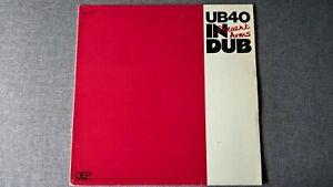 UB40 - PRESENT ARMS IN DUB (1st press) .            LP.
