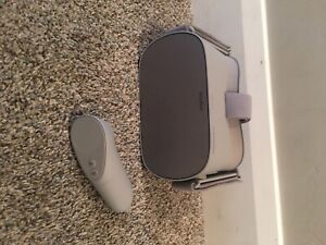 Oculus Go 64GB Virtual Reality Headset - Gray And Case With Charging Cable.