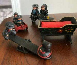 VINTAGE DALECRAFT CAST IRON AMISH FAMILY Figures Figurines Seesaw Bench Crib