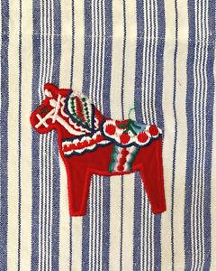 child's Swedish full bib apron, wh/blue striped cotton w embroidered Dala horse