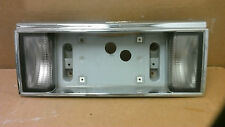 1989 - 1993 Cadillac Deville Fleetwood FWD   license plate bezel reverse lights