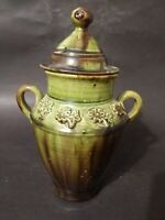 "Two Handled 8"" Olive Green & Brown Drip Glaze Pottery Urn With A Floral Pattern"