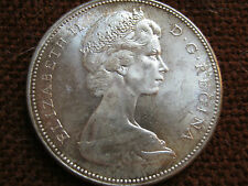 1967 Q.E.II silver canadian dollar unc. (A)